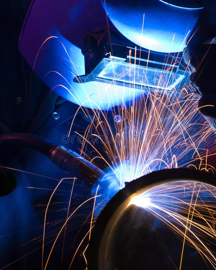 blue-lit-mig-welder-close-17363933.jpg